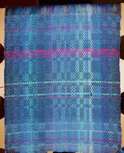 Twill blocks in silk on blue warp